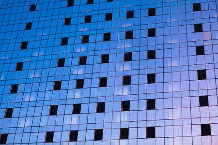 Many blue toned windows of skyscraper