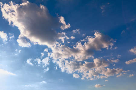 Azure daytime sky with light clouds