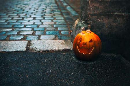 Horror pumpkin in old town . Scary street with  Jack-o'-lantern Stok Fotoğraf