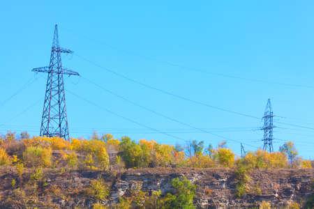 High voltage poles on the hill Stok Fotoğraf
