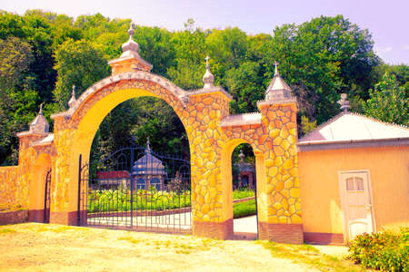 Church gate entrance with small domes Stok Fotoğraf