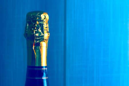 Champagne Bottle at blue Background