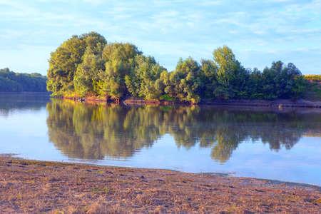 Idyllic riverside with green spring nature Stok Fotoğraf