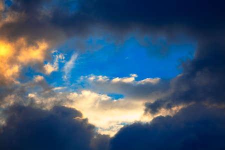 blue sky between the dark clouds