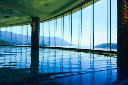 Luxury swimming pool at the hotel top . Majestic panoramic view of mountains and sea Editöryel