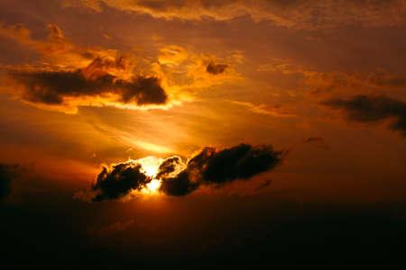 Evening sky in red tones . Black clouds in the twilight Zdjęcie Seryjne