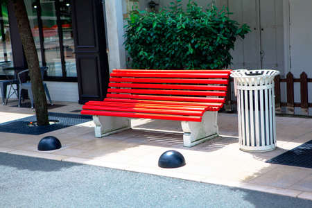 Red bench on the city street