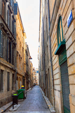 Narrow street of old town in Bordeaux . View of old traditional french street