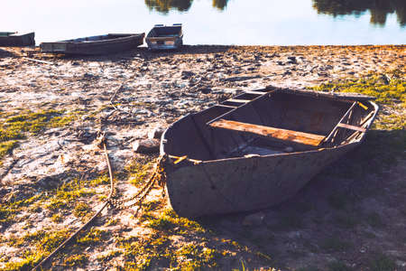 Old fishing boat on the dirty shore