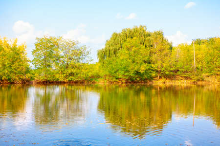 Idyllic scenery with lake . Nature reflection in the river water