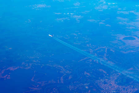 Aerial view of airplane flying over the earth