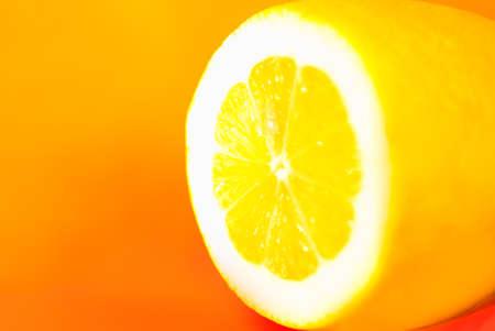 Natural fresh cut lemon at yellow Stockfoto