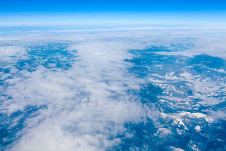 Spectacular view of snowy mountains . Aerial view of clouds and mountains . Alpine winter