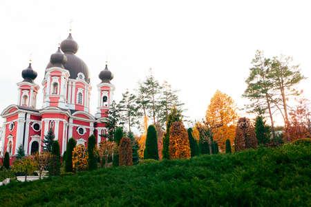Monastery and decorative garden in autumn