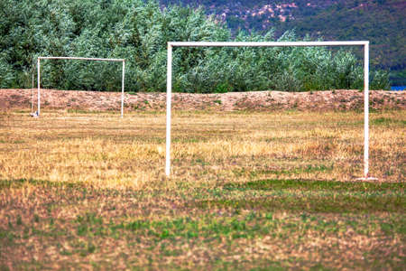 Abandoned football field in rustic area