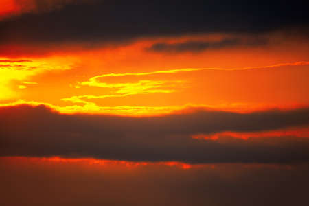 Sky in red and dark tones . Firmament during the evening