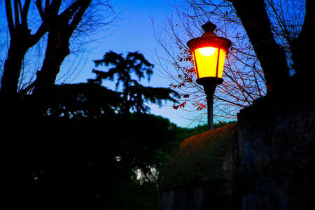 Street lamp in medieval style at dawn