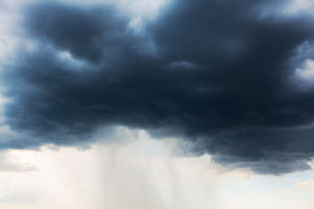 Dark clouds with torrential rain . Nebulosity with heavy rain Stock Photo