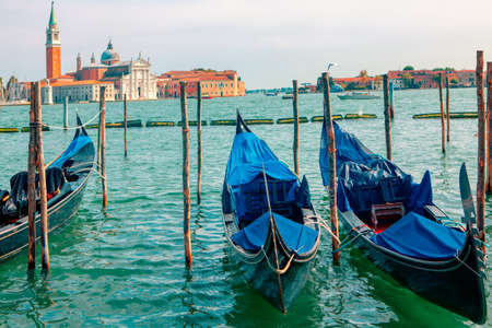 Gondolas without tourists in Venice . Old harbour with boats in Venezia