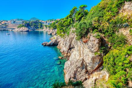 Amazing Croatian Adriatic Sea . Tourist resort at rocky coast in Croatia 写真素材