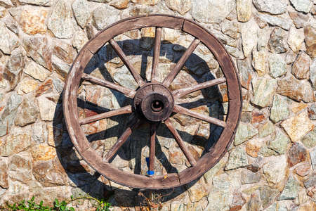 Cart Wagon Wheel . Wooden Cartwheel like a decor on the wall . Burnt wood finish . Good for ornamental use as rustic feature