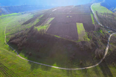 Aerial view of Country road around agricultural fields . Panoramic nature in the springtime