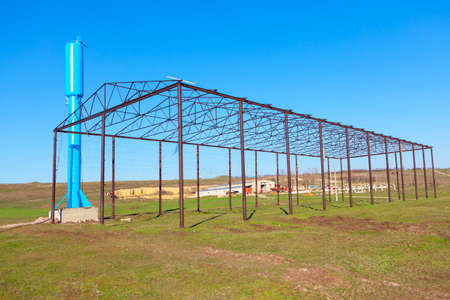 Metal structure of the greenhouse . Old abandoned farm