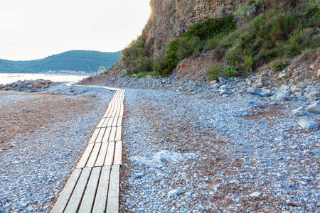 Wooden planks path for walking along the beach