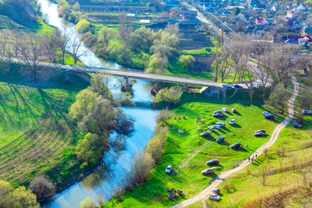 Picnic in village Trebujeni from Moldova . Aerial view of rural area and people on the riverside Imagens