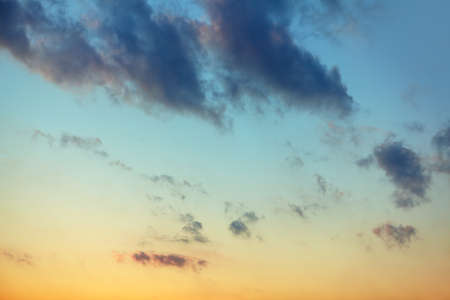 View Of Clouds In Dawn Sky . Heaven in blue and yellow tones