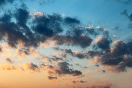 Morning clouds in the dawn light . Dark blue clouds in soft light