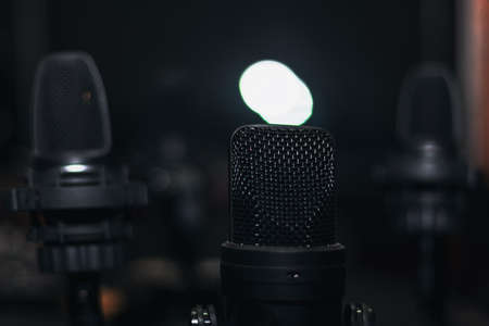 Black microphones in the dark studio Stok Fotoğraf