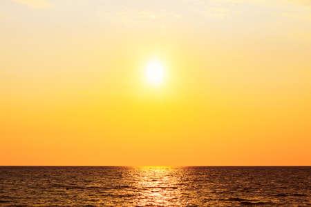 Sundown over the sea . Follow the sun . Sun over the open sea in the evening