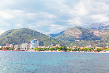 View from the sea to the Budva City in Montenegro . Adiatic Sea and Balkans scenery . Coastal city in Montenegro with resorts and hotels