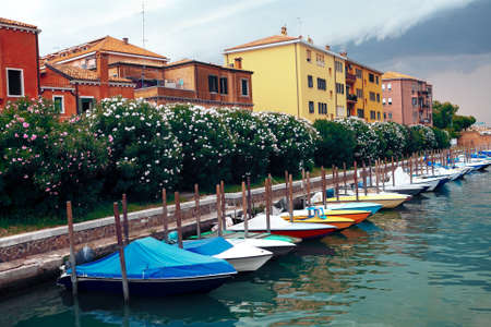 Row of moored boats . Coastal residential district in Venice