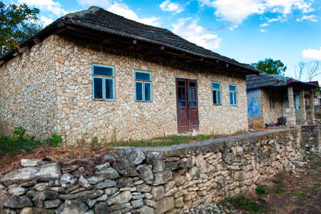 Rustic houses with rubble walls . Settlement of poor people