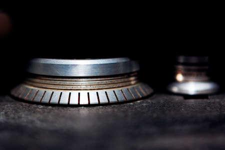 Rolling mechanism of tape magnetophone . Wheel roller for vintage tapes . Stroboscope for analog recording