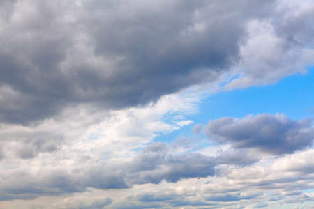 Cloudscape with gray cloudy sky . White and grey clouds