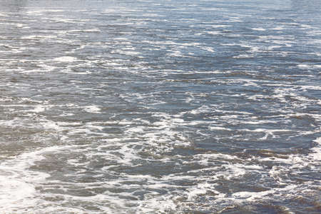 Flowing water surface . Moving water with waves pattern