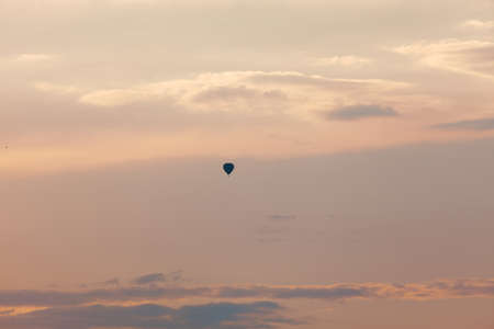 Evening sky with air balloon  . Silhouette of hot air balloon flying during sunset, Stok Fotoğraf