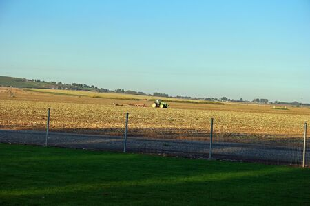 Tractor plows a field