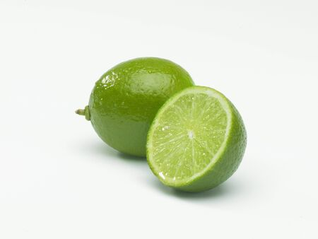 ingrediant: One whole Lime with one half lime isolated on white background