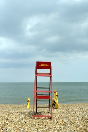 beack: a beach lifeguard post on a pebble beack looking out over the sea Stock Photo