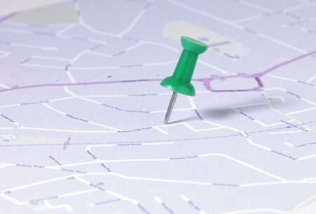 detail of a green map pin in english street map  Stock Photo - 9324179