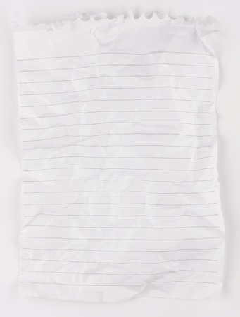 A piece of crupled and creased lined whited notepaper from a spiral bound notepad. Stock Photo - 10373620