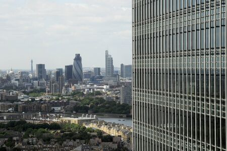 towerblock: Seen from east london and with a portion of a skyscraper. a view of the city of London skyline Stock Photo