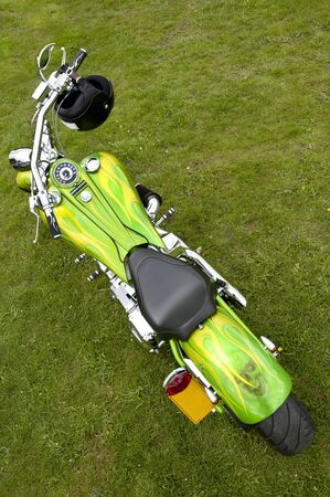 crash helmet: seen from above a custom painted green and yellow large customised motorbike with crash helmet