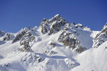 off piste: An alpine snow covered peak with off piste ski runs
