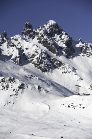 ski runs: An alpine snow covered peak with ski runs and pistes