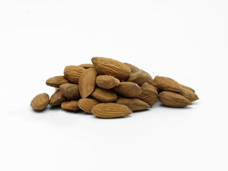 shelled: a pile of shelled Almonds on a white background Stock Photo